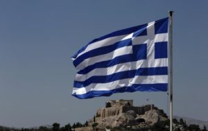 544996-a-greek-flag-flutters-in-front-of-the-acropolis-hill-in-athens